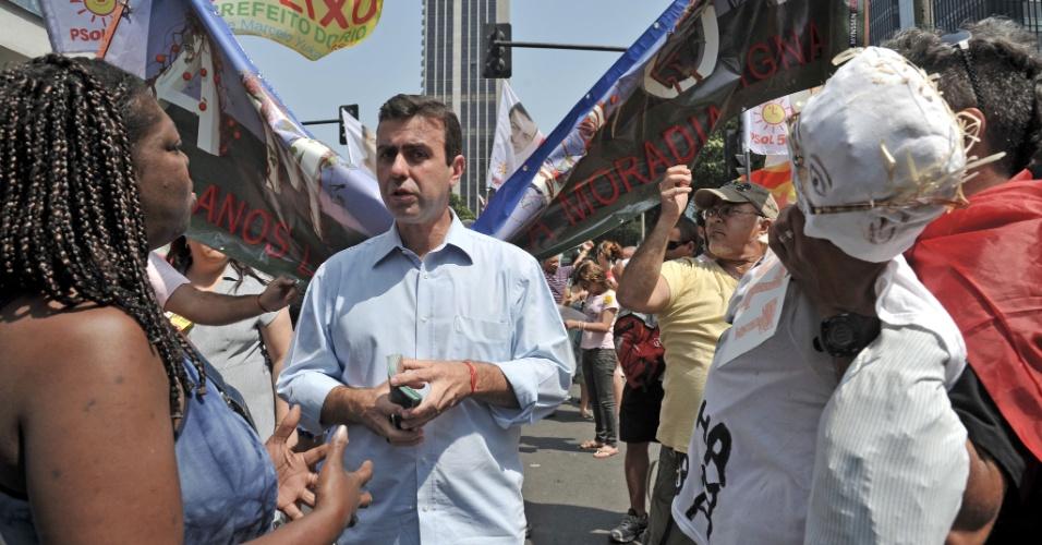 7.set.2012 - O candidato do PSOL à Prefeitura do Rio de Janeiro, Marcelo Freixo, fez campanha durante a Marcha dos Excluídos, no dia Dia da Independência