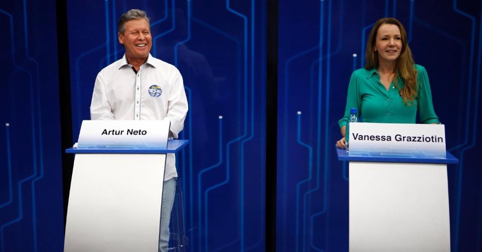 """26.out.2012 - Os candidatos à Prefeitura de Manaus, Arthur Virgílio (PSDB) e Vanessa Grazziotin (PC do B), participam de debate da """"Rede Amazônica"""" (afiliada da """"TV Globo"""") na noite desta sexta-feira"""
